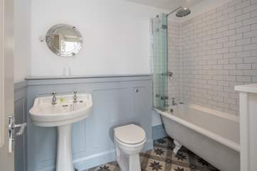 En suite to bedroom 1 boasts this rather lovely roll-top bath.