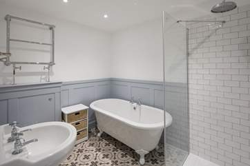 The en suite to bedroom 2 is home to a stunning roll-top bath and shower cubicle.