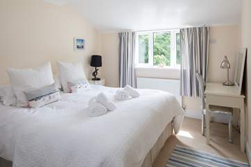 Bedroom 2 also offers a glorious super-king size bed, which can also be configured as twins on request.