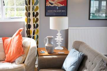 This property has been thoughtfully decorated and furnished with a warm retro feel.