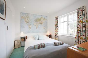 The ground floor double bedroom is full of light with a lovely feature wall.