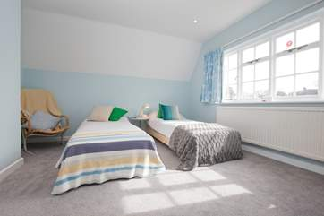The twin bedroom has plenty of space for the children to play while making lots of happy memories.