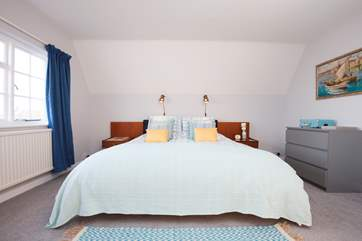 The spacious master bedroom with super king-size bed over looks the garden