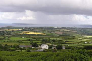 Taken from the path up Tregonning Hill, Mazey's Cottage is in the centre of the photo (beyond the chapel and surrounded by trees and fields).
