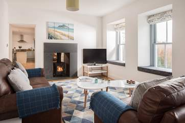 The double-sided wood-burner can be enjoyed throughout the property.