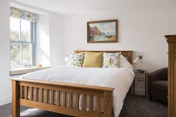 One step down takes you into the calm master bedroom (Bedroom 1).