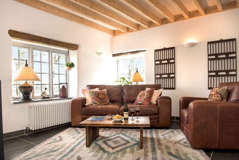 Oak lintels, slate floors and exposed beams enhance the overall character and charm.