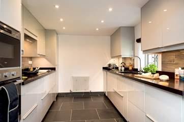 The sleek and stylish kitchen.