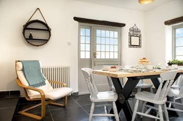 Enjoy leisurely meals at the dining-table or open up the stable-door to the garden.