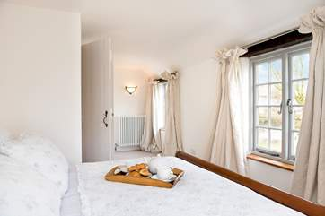 The double bedroom has a super-comfy bed which is adorned with lovely linens.