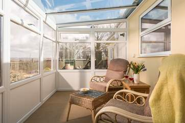 You are sure to spend many an hour in the conservatory planning the day ahead or simply taking in the view.