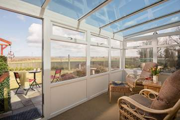The conservatory takes full advantage of the views.