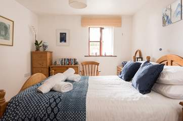 The light and bright master bedroom.