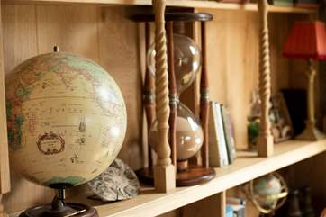 There is a cornucopia of cosmic antiques and artefacts displayed on the shelves.