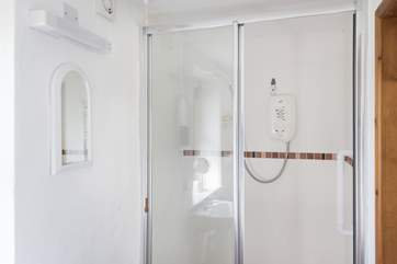 The en suite shower-room, has a step leading up to the shower.