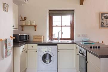 The well-equipped kitchen in the open plan living space.