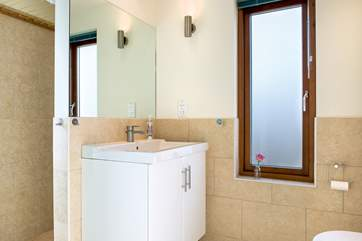 The shower-room on the ground floor is ideal for rinsing off after a great day on the beach.