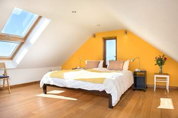 The light floods into Bedroom 3 on the second floor, which has a super-king size bed.