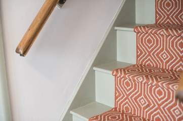 Steep cottage stairs lead up to the bedrooms.