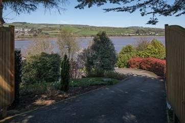 The main gates open leading you down your private driveway to the parking area below. What a view to start your holiday off with!
