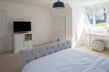Another angle of bedroom 3, showing a glimpse of the lovely view over the garden.