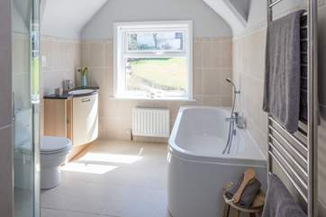 Family bathroom with shower cubicle and bath with shower attachment.