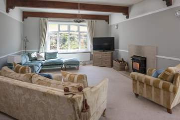 The main sitting-room boasts a glorious wood-burner. Perfect for those snuggly nights in.