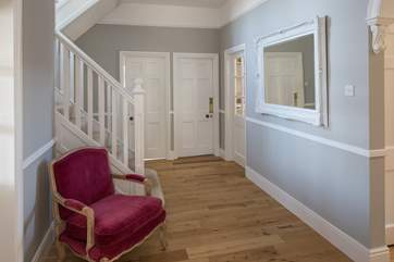 Meadowcliff is linked by this ground floor hallway, which leads to the stairs and up to the first floor.