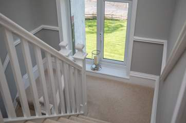 The 2-tiered staircase wind up to the first floor, offering wonderful views on the way.