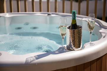 Anyone for a glass of something tasty whilst soaking in the bubbles and sunshine?