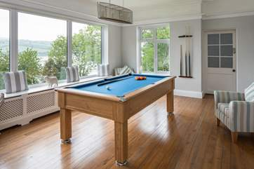 The games room boasts this wonderful pool table. Hours of fun to be had here whilst looking out over the water.