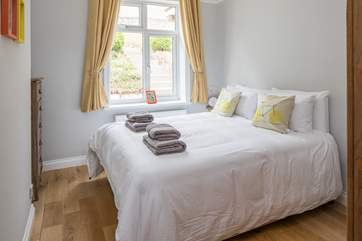 The king size double bed on the ground floor. Bedroom 1.