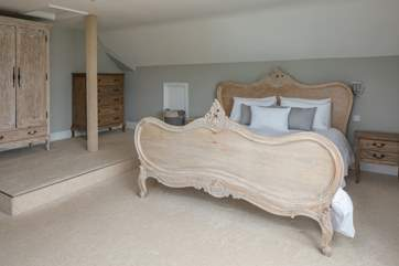 The master bedroom is super spacious. Please watch the step when accessing the wardrobe.
