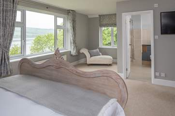 Fabulous views over the water and garden can be enjoyed from the master bedroom.