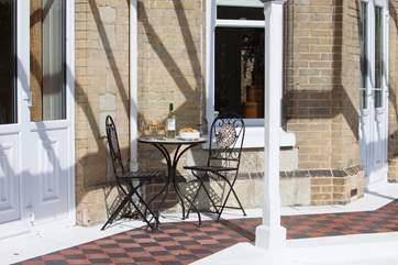 Take a seat on the sunny veranda as the evening draws in with a glass of wine