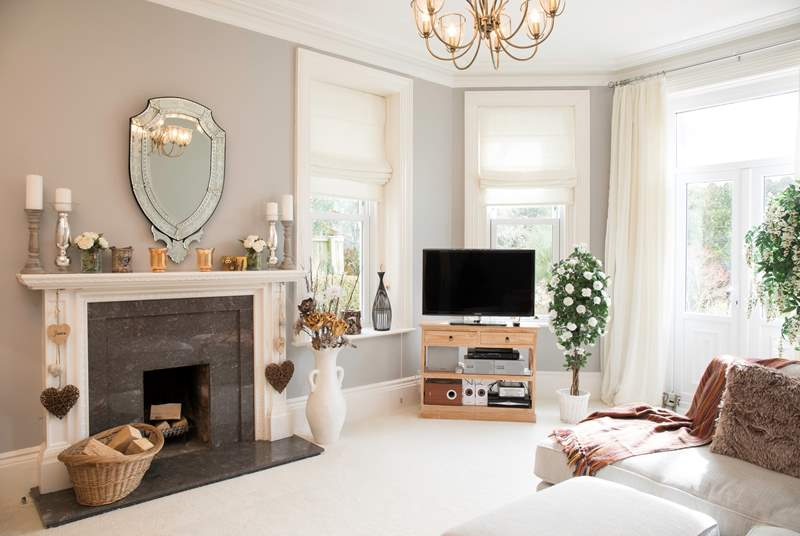 The elegant sitting-room is a beautiful space to relax in