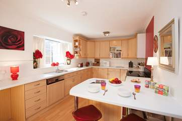 The large kitchen gives you plenty of space to prepare, cook and eat at the breakfast bar