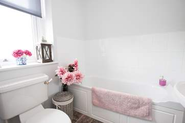 Fill the bath and pour in the bubbles for a relaxing soak in the bath in the family bathroom