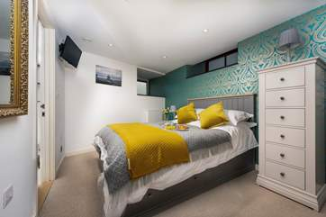 The master bedroom has a TV and an en suite shower-room.