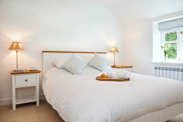 All three bedrooms are light and airy with crisp white linen on the beds.