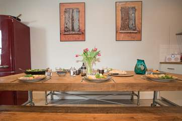 The dining furniture has been shipped in from Indonesia and is the focal point in the kitchen area.