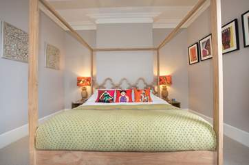 The master bedroom features a gorgeous super-king four-poster bed.