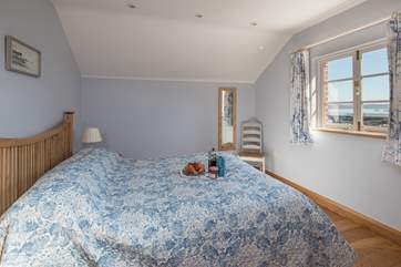 The large double bedroom also boasts amazing water views.