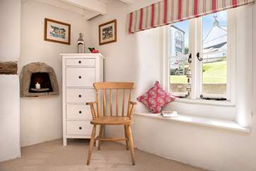 The cottage retains some original features adding to the overall charm.