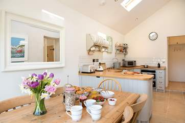 The kitchen/dining-room is wonderfully light and airy.