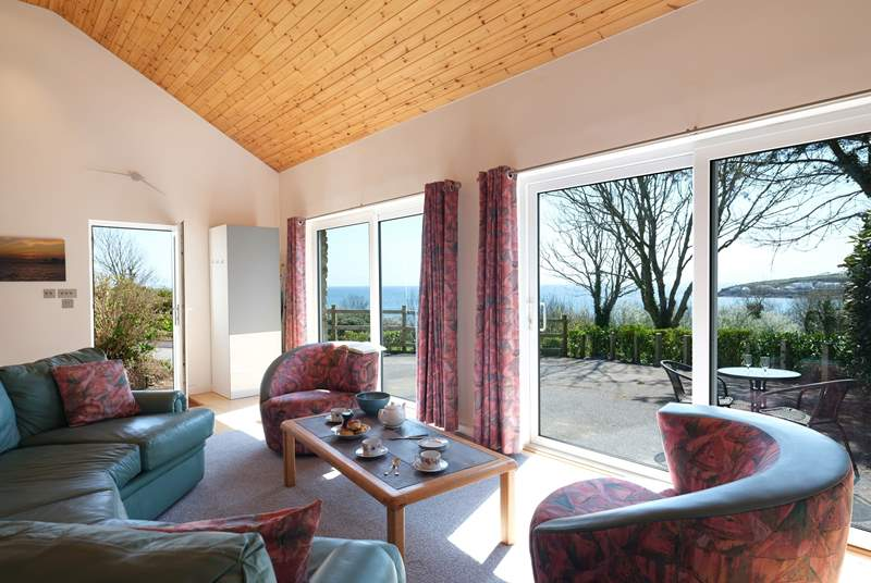 The sitting-area has double patio doors so the stunning view can be enjoyed all the year round.