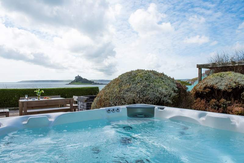 Relax on the sunny terrace, take in the views from the hot tub.