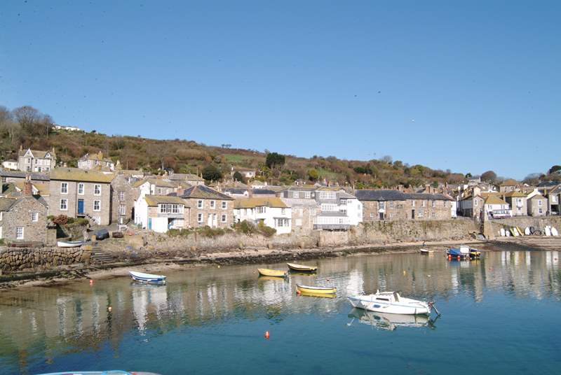 Mousehole Harbour nearby.
