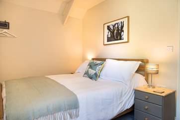 Bedroom 2 is decorated in restful tones.