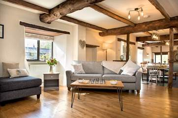 The open beams and wooden floors add to the overall character and charm.
